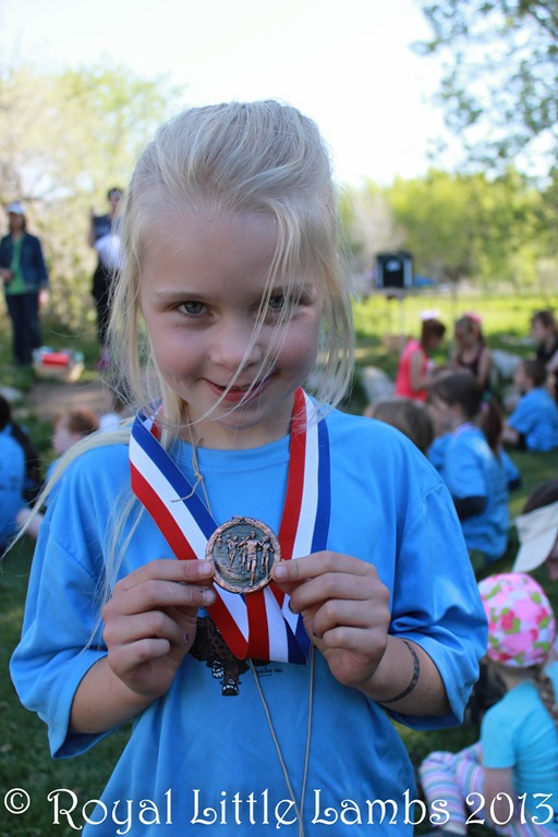 youngest participant 5K medal.jpg