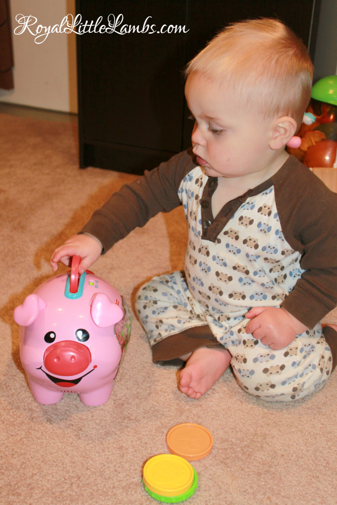 Playing with His Piggy Bank