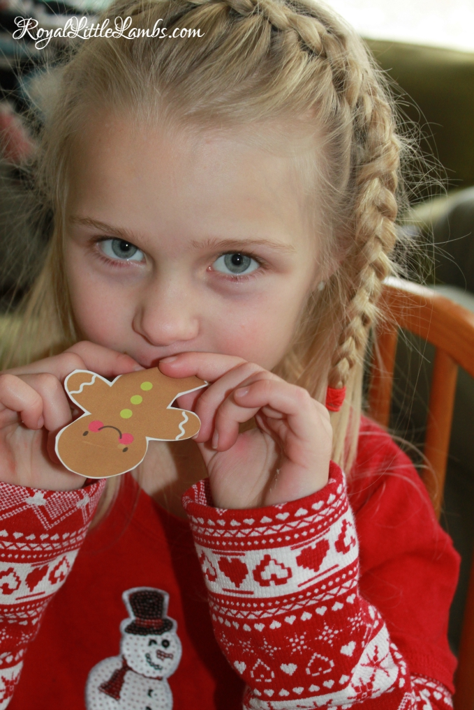 Pretending to Eat Gingerbread Cookies